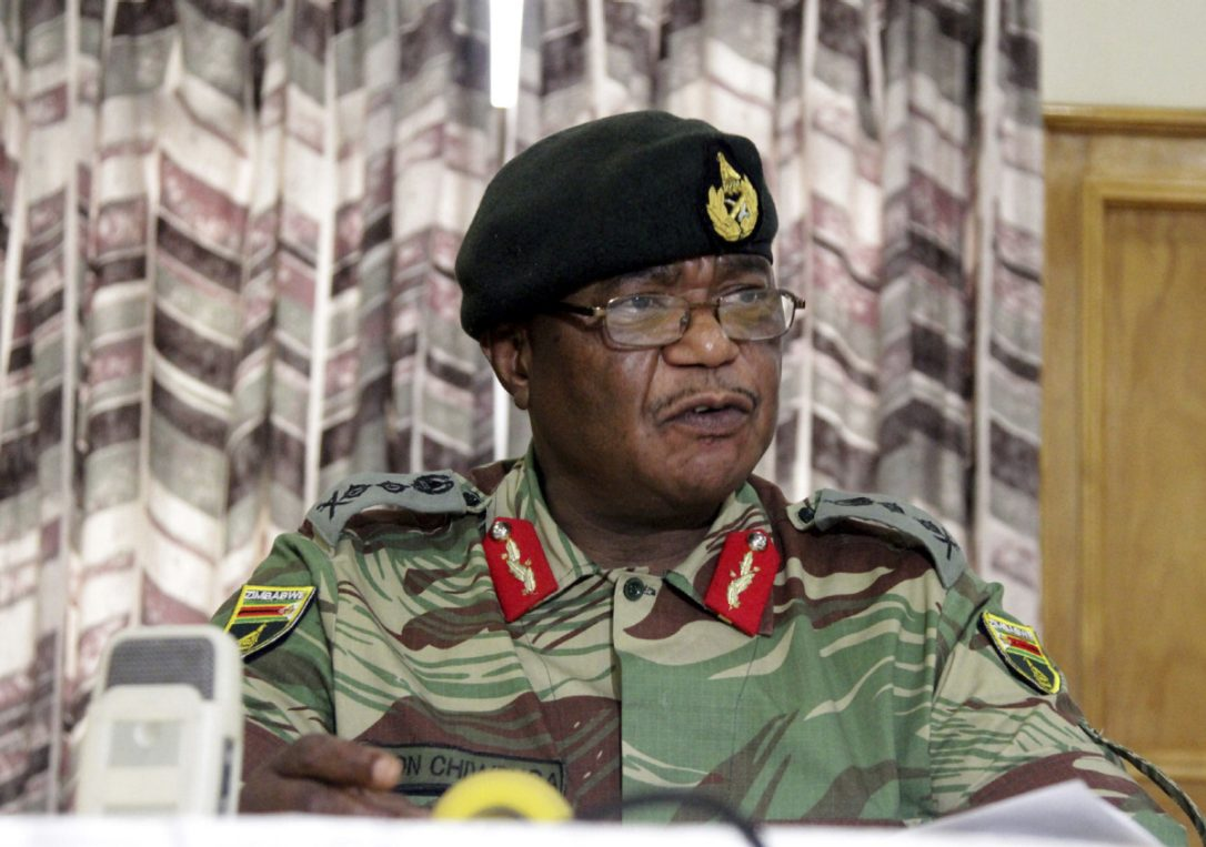 "Zimbabwe's army commander Constantine Chiwenga said the security services would stop those ""bent on hijacking the revolution,"" signalling a split with the 93-year-old leader.  (TSVANGIRAYI MUKWAZHI / THE ASSOCIATED PRESS)"